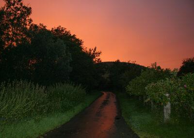 Sunset in Dernol, looking west from outside Glandernol
